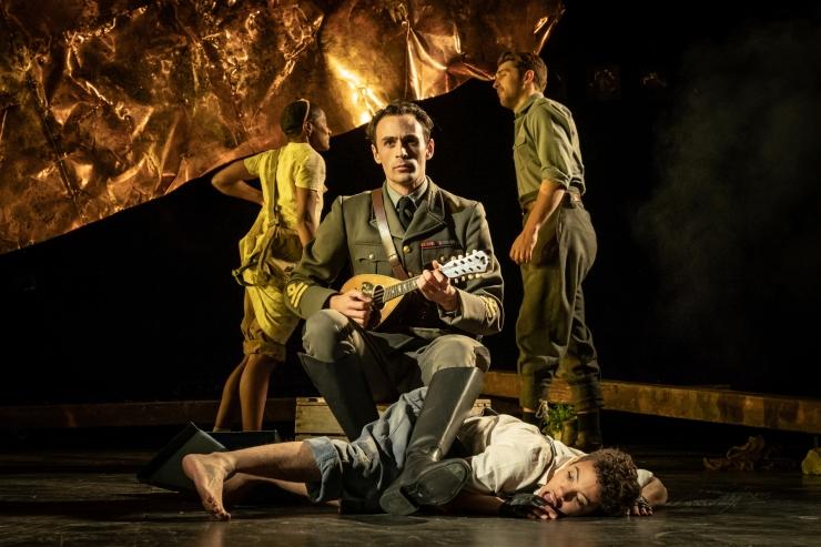 Captain Corelli's Mandolin - (centre) Alex Mugnaioni as Captain Corelli, Elizabeth Mary Williams as Psipsina - Credit Marc Brenner